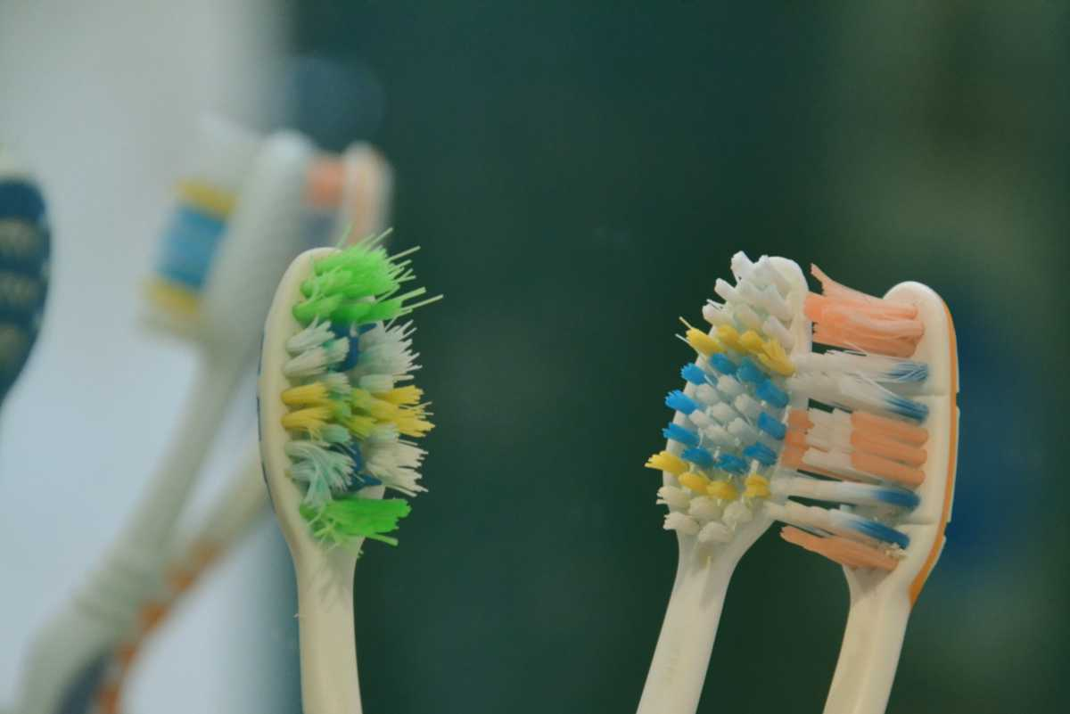 green yellow and blue manual toothbrushes