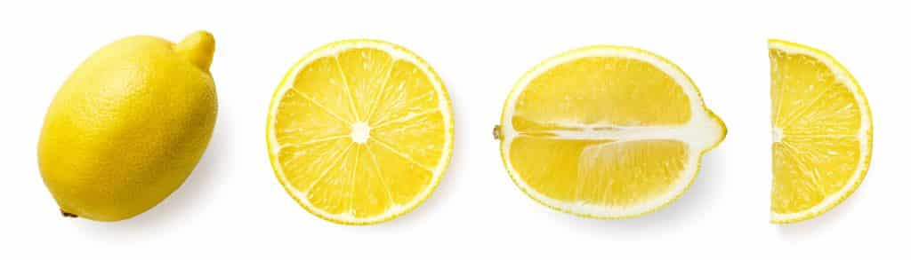 A lemon cut in 3 ways - in half width wise, in half length wise and in a quarter